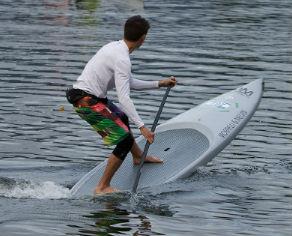 instructor demonstartg pivot turn on a stand up paddleboard