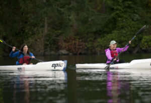 Two awesome women surfskiing deep cove
