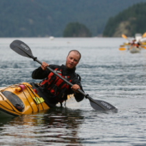 instructor demonstrating edging a kayak