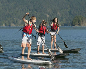 kids paddleboarding in deep cove