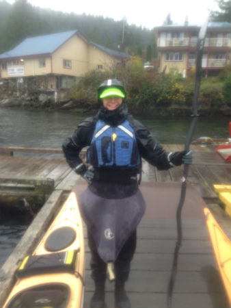 Paddler in drysuit and paddlegear