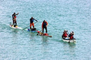 SUPs drafting canoes at the Yukon River Quest