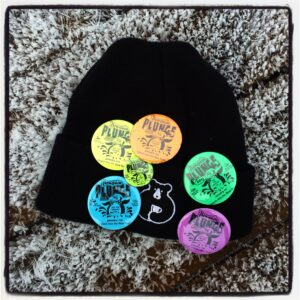 Johnny Hayward Penguin Plunge badges on his Cafe Orso toque