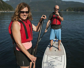stand up paddleboarders in deep cove