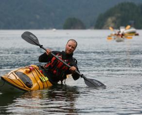 instructor demonstrating edging a kayak