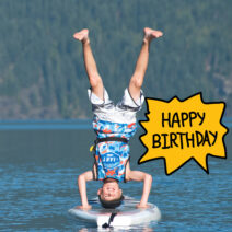 Boy headstand on paddleboard